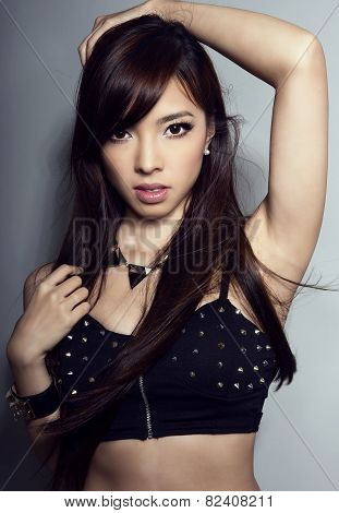 young beautiful asian woman with flawless skin and perfect make-up and brown hair