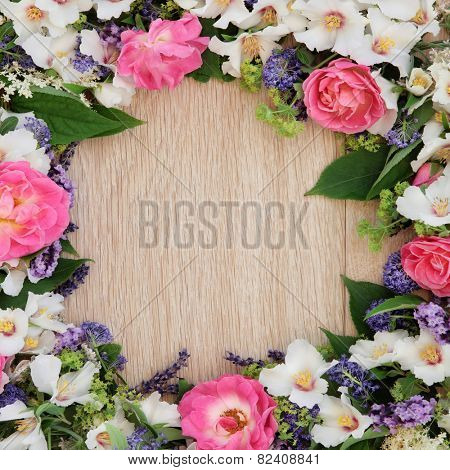 Summer flower border over light oak background.