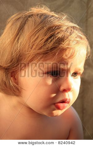 Baby With Dramatic Sunlight