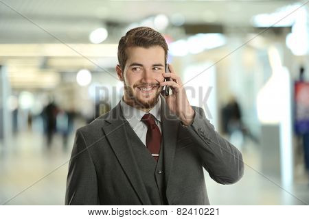 Young Businessman on the cell phone at the airport