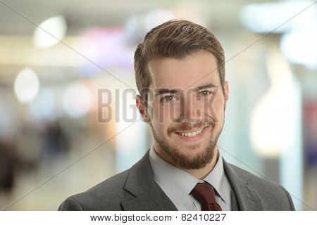 Young Businessman at the airport with background out of focus