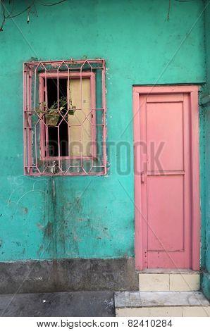 KOLKATA, INDIA - FEBRUARY 07: Colorful indian house. Bright green building in Kolkata, West Bengal, India on February 07, 2014.