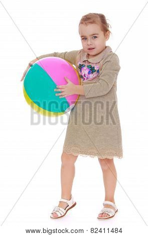 Little girl with big inflatable ball.