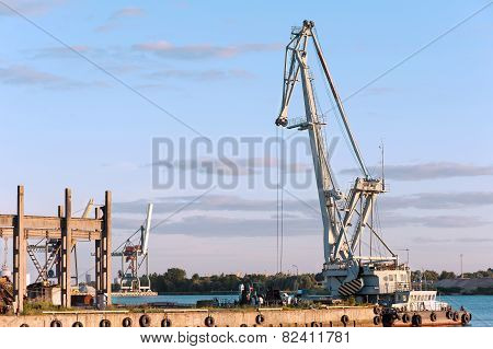 Floating Cargo Crane On Barge Near Quay. Mooring In Riga.