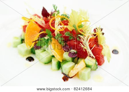 Tuna tartar with cucumber and orange, close-up, not isolated