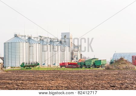 Farm Grain Storage Bins. Outdoors.