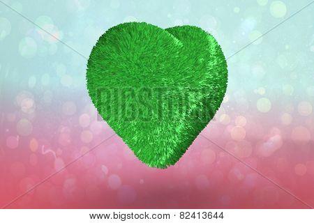 Green heart against blue and pink light spot design