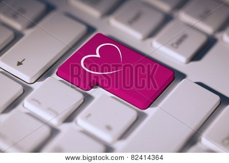 Heart against pink enter key on keyboard
