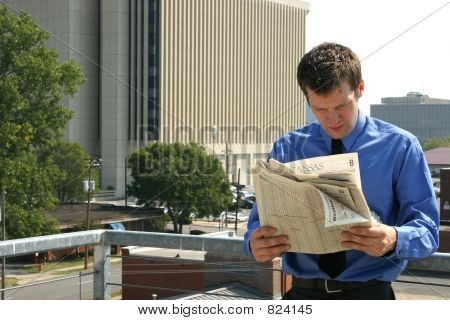 poster of Man and Newspaper in City