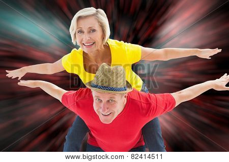 Mature couple joking about together against digitally generated twinkling light design
