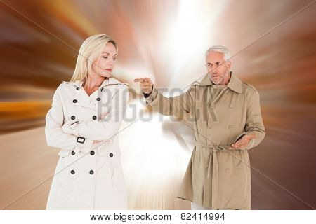 Angry couple fighting in trench coats against blurry new york street