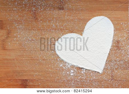 shape of heart on wooden background
