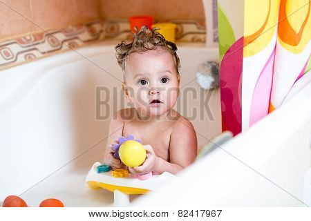 toddler boy taking a bath