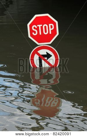 USTI NAD LABEM, CZECH REPUBLIC - JUNE 5, 2013: Stop and No right turn, traffic signs flooded by the swollen Elbe River in Usti nad Labem, Northern Bohemia, Czech Republic, on June 5, 2013.