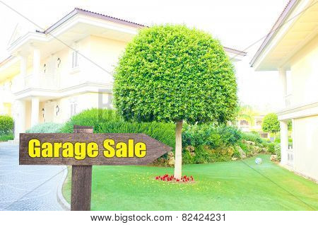 Garage sale sign in front of new house