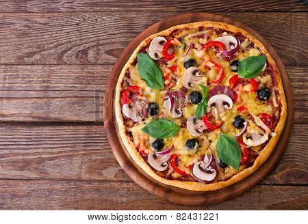 Pizza with seafood on wood table top view