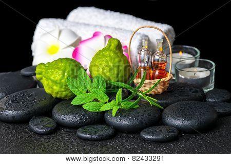 Aromatic Spa Setting Of Bergamot Fruits, Fresh Mint, Rosemary, Candles, Towels, Flower And Bottles E