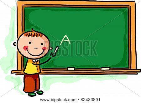 Little boy at the blackboard