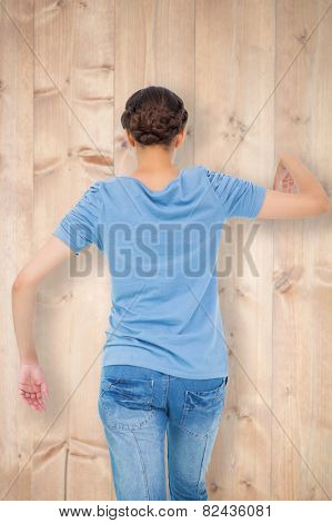 Powerless brunette against bleached wooden planks background