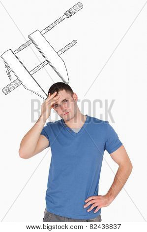 Portrait of a man having a headache against blue background with vignette