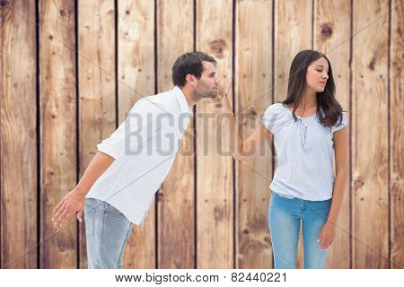 Brunette uninterested in mans advances against wooden planks background