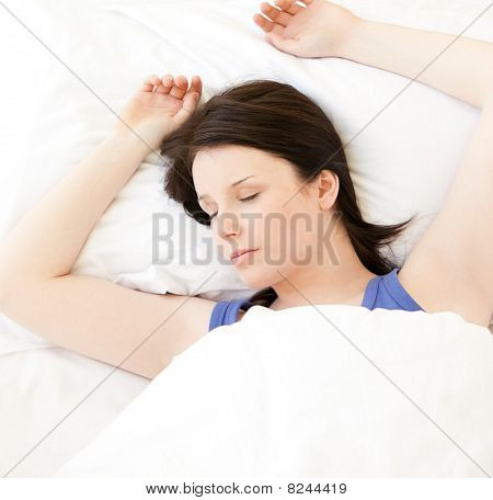 Cute Young Woman Sleeping In Her Bed