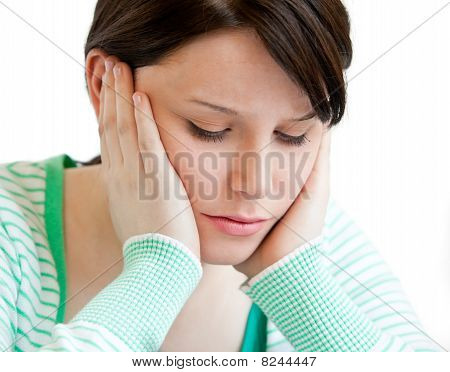 Portrait Of A Depressed Teenager Holding Up Her Head On Her Hands
