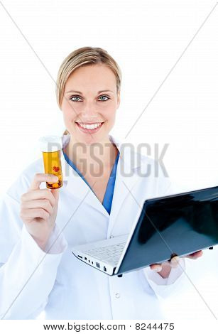 Smiling Young Doctor Holding A Laptop And Pills