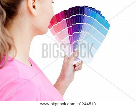 Beautiful Young Woman Choosing Colours In Her Living-room