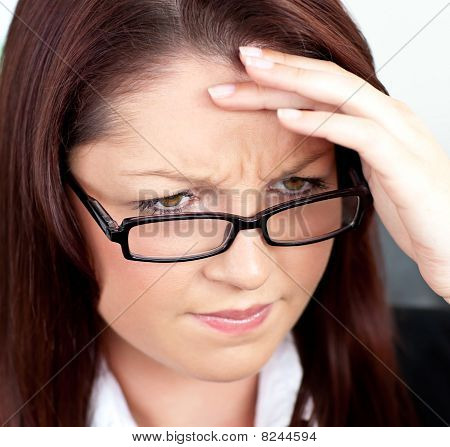 Portrait Of A Stressed Woman Wearing Glasses