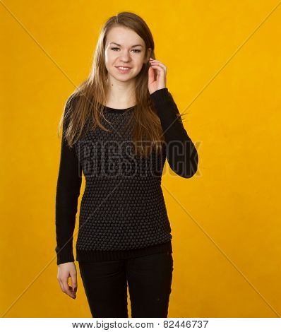 Girl On A Background Of Orange Wall