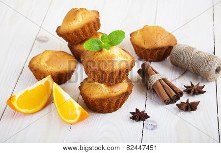 Muffins on white wooden table