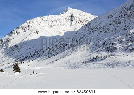 Ice Diving At A Frozen Lake In The Austrian Alps
