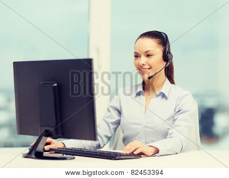 business, communication and call center concept - friendly female helpline operator with headphones