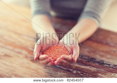 cooking and home concept - cloes up of female cupped hands with quinoa