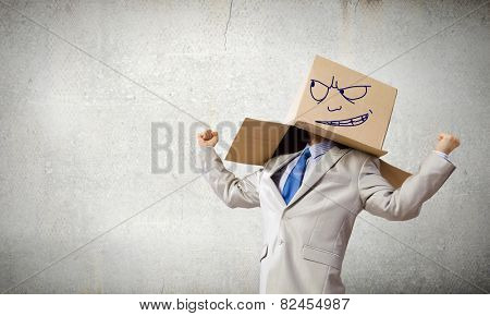 Businessman wearing carton box with drawn emotions on head