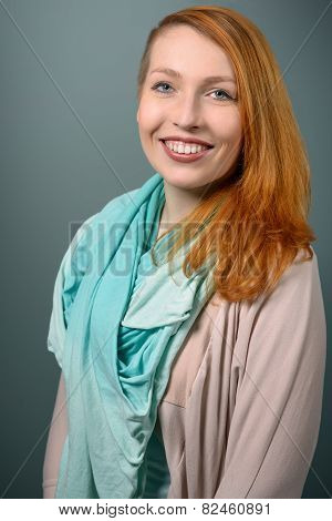 Smiling Red Haired  Woman With Scarf Looking At Camera