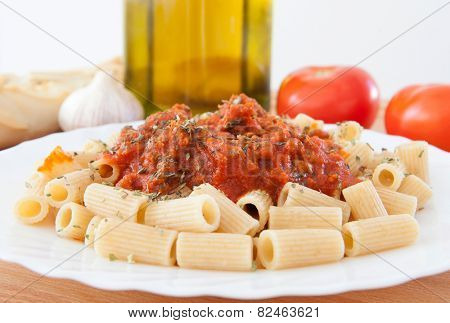 Delicious plate of macaroni with tomato ingredients background