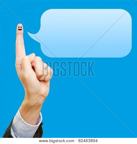Funny index finger with smiley and an empty blue speech bubble