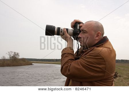 Photographer At Park Against  River