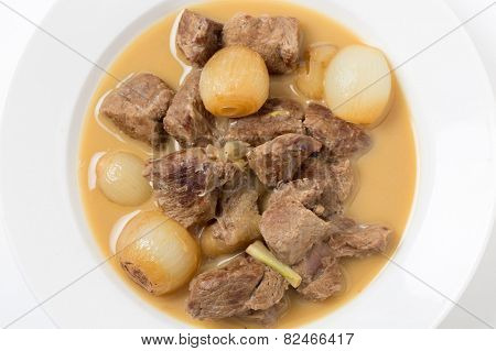 Traditional Italian and Greek lamb fricassee with small onions, finished with an egg and lemon sauce.