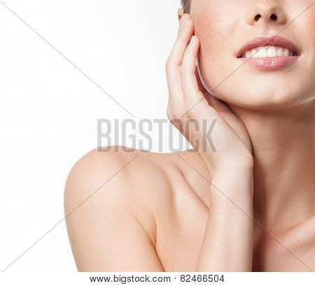 closeup portrait of attractive  caucasian smiling woman isolated on white studio shot lips toothy smile face hand tooth