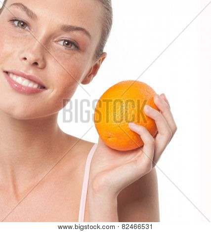 beauty portrait of attractive young caucasian smiling woman isolated on white studio shot with orange fruit