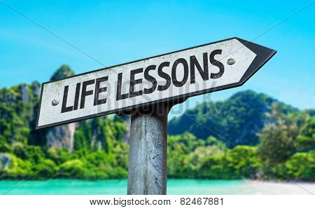 Life Lessons sign with a beach on background