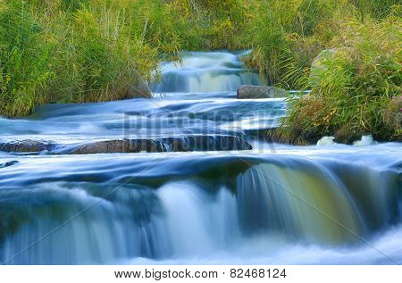 Blue water on cascade of river