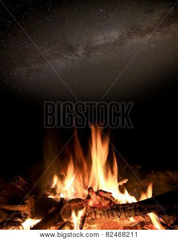 Night scene with fire under stars in sky