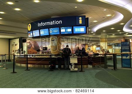 Vancouver, BC Canada - September 13, 2014 : People asking some information insdie the YVR airport in Vancouver BC Canada.