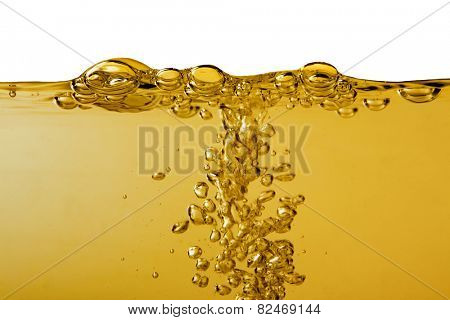 Yellow liquid with bubbles on white