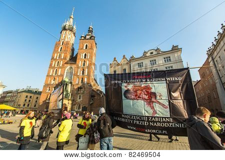 KRAKOW, POLAND - FEB 7, 2015: Unidentified participants protests against abortion on Main Market Square near Church of Our Lady Assumed into Heaven (also known as St. Mary's Church)