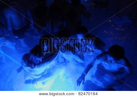 BUDAPEST - NOVEMBER 2, 2013: Tourists enjoy the Magic Bath Party at the Lukacs Bath, a traditional night party in a outdoor thermal bath, in Budapest, Hungary, on November 2, 2013.